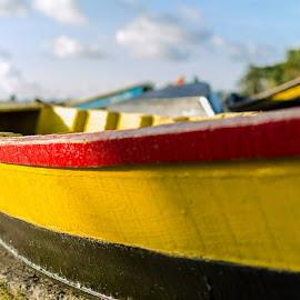 The Yellow Boat by Joybrata Chakraborty - Transportation Boats