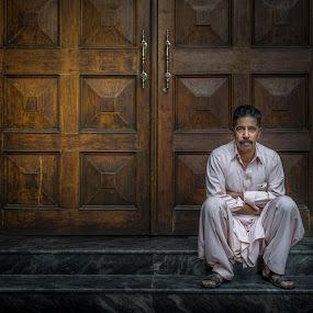 Man  by Walid Ahmad - People Portraits of Men ( waiting, door, photo, photography, man )