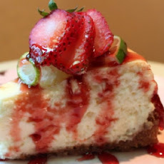 Key Lime Cheesecake With Strawberry Butter Sauce