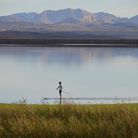 Alone on the Lake by Thomas Shaw - People Portraits of Men ( water, mountains, mountain, surfing, surf board, green, relaxing, alone, man )