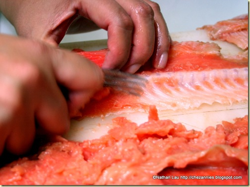 Scraping Salmon Meat From the Bones