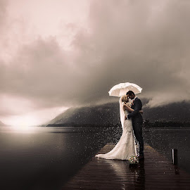 who needs sunshine on a wedding day by Rob Venga - Wedding Bride & Groom ( sunset, wedding, umbrella, lake, rain )