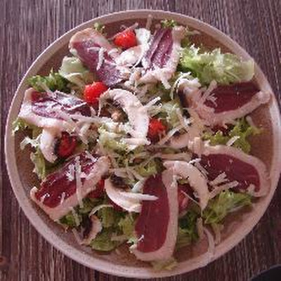 Smoked duck breast salad with walnuts and Parmesan cheese shavings