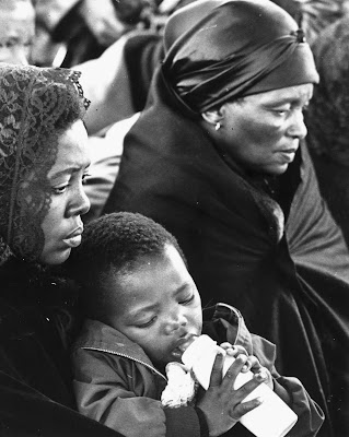 Mrs. Alice 'Mamcete' Biko, Mrs. Ntsiki Biko and son, Samora-age 2-at Biko's funeral
