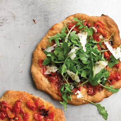 Individual Pizzas with Pecorino, Arugula, and Tomatoes