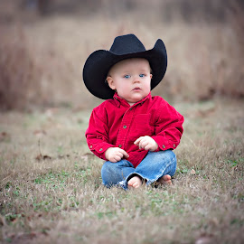Lil One by Carole Brown - Babies & Children Child Portraits ( cowboy hat, one year old boy, red shirt, blue eyes, sitting in the grass )