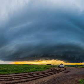 Over in Iowa by Eric Anderson - Landscapes Weather ( iowa, grass, weather, cloud, stuck, chase, severe, road, landscape, storm, tornado )