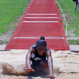 Splashdown in the sand. by James Mathews - Sports & Fitness Other Sports ( track and field, long jump )