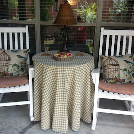 I set up a new table between the rockers with a lamp. Now we can sit outside at night and play some ladybug checkers while having a drink in soft light from the lamp. How romantic!...and cute. by Sherri Murphy - Novices Only Objects & Still Life