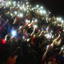 A Brilliant Assortment by Kayla Bonack - People Group/Corporate ( lights, concert, united, flashlight, assembly, wave, cell phone, people )