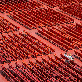 Red Chairs by Dobrinovphotography Dobrinov - Abstract Patterns ( full frame, sports venue, plastic, in a row, open-air theater, large group of objects, chair, red, metal, seat, no people, event, outdoors, stadium, empty, auditorium, repetition )