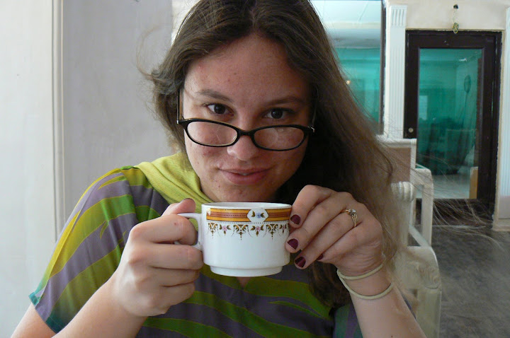 Sarah sips her tea at breakfast
