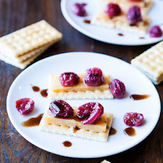 Roasted Grapes and Balsamic Reduction with Cheese and Crackers