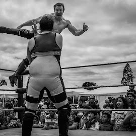 catch me if you can by David Prentice - News & Events Entertainment ( monochrome, black and white, wrestling, white, funny, jump funny, wrestle, school, wrestlers, men, glala day, black, man )