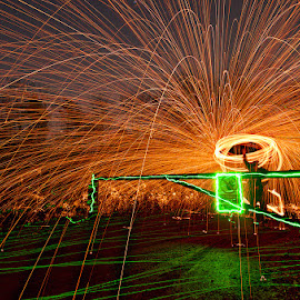 Spinning the gate - 08-03-14 by Mark Airey - Abstract Light Painting ( light painting, night photography, steel wool, sigma, d7000, long exposure, nikon, sparks, gate )