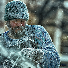 Old Man Winter 6 by Bill Tiepelman - People Street & Candids ( minnesota, winter, cold, sculpting, ice, carving, saint paul winter carnival, chainsaw, man )