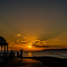 Skateboarders at sunset by Andy Kay - Sports & Fitness Skateboarding ( skateboarding, sunset, silhouettes, sport, evening, skateboard, coast )