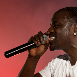 Close-up of black singer Akon on stage by Nick Dale - People Musicians & Entertainers ( concert, t-shirt, white, singer, turkey, bodrum, smoke, black, close-up, akon )