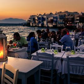 Candle lightening the sea by Pedro Silva - City,  Street & Park  Street Scenes ( tables, candle, hellas, mykonos, sunset, aegean sea, greece, pedrosilvaimages, little venice, pedro silva, people )
