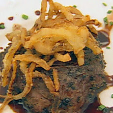 Peppercorn Encrusted Beef Tenderloin on Beef Tomato with Goat Cheese, French Fried Onions and Balsamic Vinegar Sauce