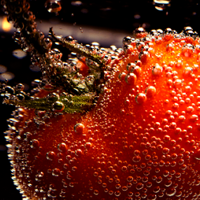 A tomato by Roman Kolodziej - Food & Drink Fruits & Vegetables ( clear, water, tomato, fresh, zoom, bubbles, Food & Beverage, meal, Eat & Drink )