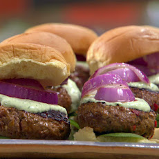 Indian Lamb Burgers with Green Raita Sauce and Red Onions