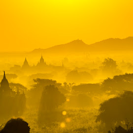 The misty morning in Bagan Archaelogical site. by Khun Myo Than Htun - Landscapes Travel ( temples, trees, stupa, rays, sun )