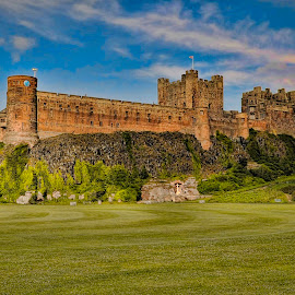 Bamburgh Castle by Graham White - Buildings & Architecture Public & Historical ( royalty free stock photographs, english castle, photographs, stock photos, northumberland, bamburgh, photography, historic, stock photographs, coastal castle, stock images, fortress, images, royalty free stock photos, castle, bamburgh castle, royalty free stock photography )