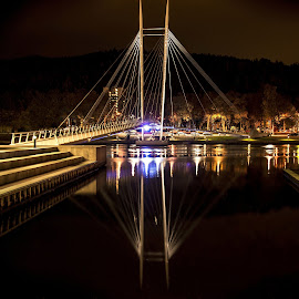 Ypsilon Bridge By Night by Lillian Molstad Andresen - Buildings & Architecture Bridges & Suspended Structures ( water, drammen city, hill, streetlight, silhouette, reflections, city, norway, stairs, drammen, ypsilon bridge, trees, night, ypsilon, bridge, light, river,  )