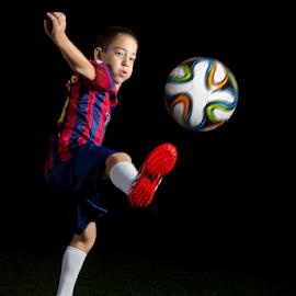 Boy in Barcelona Football Uniform by Dotan Naveh - Sports & Fitness Soccer/Association football ( messi, #10, player, barca, cute, spain, kid, caucasian, child, argentina, ballgame, qatar airways, dark, young man, barcelona, athlete, soccer, ball, world cup, spanish, lionel, uniform, low key, grass, leo, sport, qatar, team, fun, game, stripes, fan, young, fc, 10, red, football, blue, lionel messi, israeli, footballer, night, proud, boy, athletic )