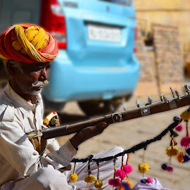 The Ancient Musician by Nilanjann Nandy - People Musicians & Entertainers ( faces, musical, folk, rajasthan, nilanjan, nilanjann, instrument, people, bowing, portrait, nandy, sound, musician, men, ravanatha )