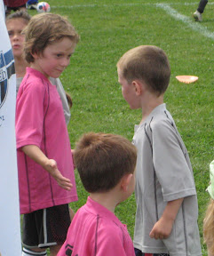 BigE shaking hands with the pink panthers