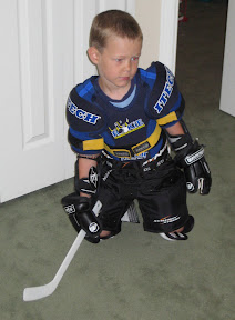 Bige in his hockey gear making a save