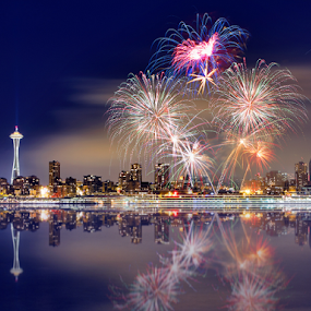 Seattle skyline with fireworks by William Lee - City,  Street & Park  Skylines ( skyline, reflection, ocean, city, holiday, washington, urban, bay, seattle, fireworks, long exposure, night, downtown,  )