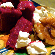 Roasted Beets With Spicy Glaze, Toasted Walnuts, Goat Cheese, And Candy Shallots.