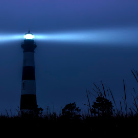 Bodie Island Lighthouse in the Fog by Greg Glaser - Buildings & Architecture Public & Historical ( bodie island, fog, outer banks, lighthouse, night )