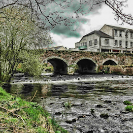 Aughrim by Philip McKibbin - Instagram & Mobile iPhone ( aughrim, water, masonry, clouds, ireland, storm, riverbank, arklow, bridge, stones, rocks, rain, river )