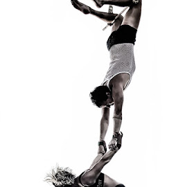 Acrobats by Jim Merchant - People Musicians & Entertainers ( high key, acrobats, daring, couple )