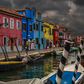 Poles Apart by Sean Heatley - City,  Street & Park  Street Scenes ( water, houses, vivid, boats, burano, travel, poles, canal, impact, colour, path, venice, italy )