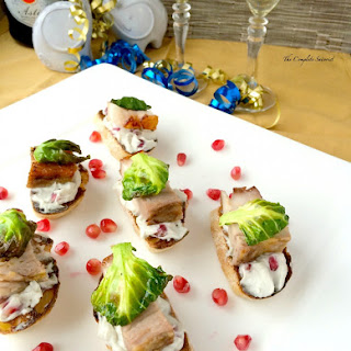 Pomegranate Pork Belly Crostini