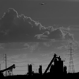 Rock Quarry by Deb Bulger - Buildings & Architecture Other Exteriors ( industrial, black and white, clouds formations, rock quarry, electrical lines, planes )