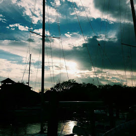 The Lady at Battery Park by Krista McMullen - Instagram & Mobile Android ( water, clouds, nature, sunset, boats, mood, weather )