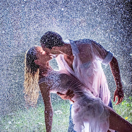 Dancing in the rain by Charlotte Hellings - People Couples ( models, love, model, couple, rain, portrait, Lighting, moods, mood lighting )