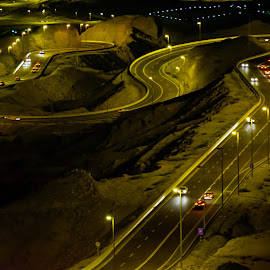 Curves by Bryx Kleiner - Landscapes Mountains & Hills ( lights, mountain, night, yellow, road, golden,  )
