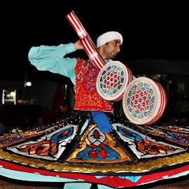 In rhythm.. by Anoop Namboothiri - People Musicians & Entertainers ( music, skirt, dri=um, desert, instrument, dancermale, entertainment, performance, safari, uae, anoop namboothiri, night, dancer,  )