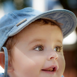 Camera shy by Laura Prieto - Babies & Children Babies ( baby with cap, blue, baby big eyes, baby smile, baby model axel, baby boy )