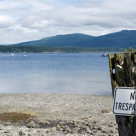 No Trespassing by Wade Tregaskis - Landscapes Travel ( clouds, sign, cold, boats, no trespassing, beach, boat )