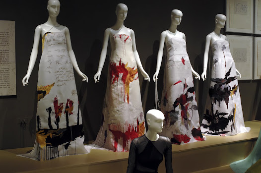 "Rucci's ultimate tribute to the artist Cy Twombly is a suite of gowns entitled ""Le Quattro Staggione."" Based on the artist's 1993-94 series of four enormous canvases, the dresses are emblazoned with color, movement, imagery, and even text from the Twombly paintings."