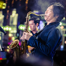 Grooving Pleasures  by Jere C - People Musicians & Entertainers ( saxophone, fujifilm, dramatic, orchard road, singapore )