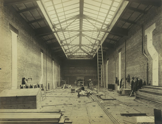 The structure of the house's Art Gallery was largely in place by early October 1913.  Note the coats and hats of workmen hanging along the walls.